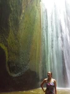 splashing around at a waterfall in Bali
