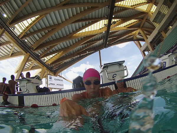 swimming in the New Clark City Aquatic Center competition pool