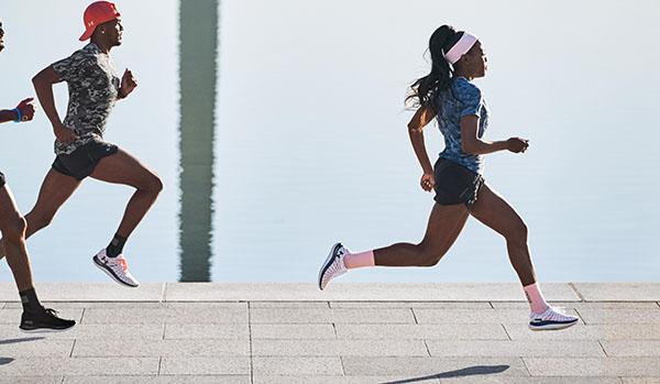 runners wearing the UA Flow Velociti Wind